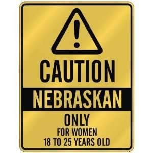 CAUTION  NEBRASKAN ONLY FOR WOMEN 18 TO 25 YEARS OLD  PARKING SIGN